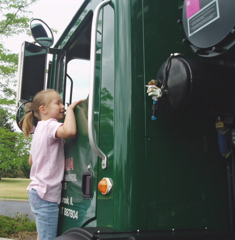 kid on recycle truck 2